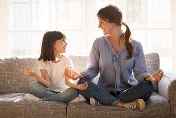 Parent and child meditating